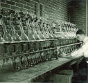Man working with distillery equipment, The University of Iowa, 1930s