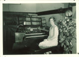 Woman seated at organ, The University of Iowa, 1920s