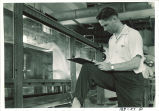 Student taking notes in Hydraulics laboratory, The University of Iowa, 1950s