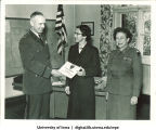 Jean Homewood of the US Army Europe Special Services Athletic Program receiving a certificate, The University of Iowa, November 13, 1957