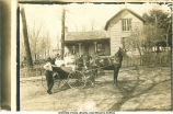 Men, women, and carriage in front of a house, Marion?, Iowa, February 4?, 1909