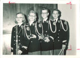 Marching band members in uniform, The University of Iowa, 1960s