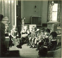 Children with musical instruments seated around piano, The University of Iowa, February 22, 1938
