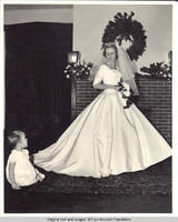 Unknown child and Frindy Gronen looking at each other in living room