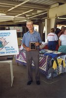 1998 - Harold Linder stands holding a plaque as the winner of the first Gary Wagner Memorial Stewardship Award