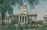 Students walking by east side of Old Capitol, the University of Iowa, 1960s