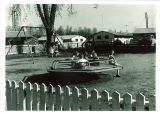 Children on playground of a married housing unit, the University of Iowa, April 18, 1958