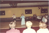 Singer and accordionist at Scottish Highlander banquet, The University of Iowa, May 1978
