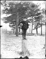 UP575 Boy with ball on stump
