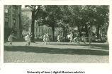 Women in Greek costume dancing on the Pentacrest lawn, The University of Iowa, 1920