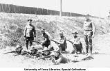 Rifle team members on ground near Armory, captain standing, The University of Iowa, 1918