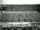 """The ISU Marching Band forming the word """"""""State"""""""" on the football field at Homecoming, 1974"""