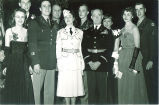 Military personnel with with partners in fancy dress, The University of Iowa, 1950s?