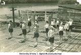 Land drill demonstrating change paddles, The University of Iowa, 1930s