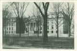 Hall of Liberal Arts with iron-spiked fence in foreground, The University of Iowa, 1900s