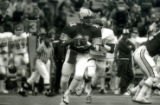 ISU quarterback ready to pass during the Homecoming Game, 1985