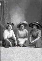 Three women sitting on floor