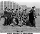 VIPs inspecting the ranks on field next to Armory, The University of Iowa, 1929
