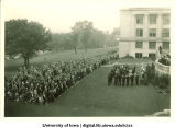 Induction ceremony on west side of Old Capitol, The University of Iowa, 1920s