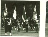 Scottish Highlanders displaying flags, The University of Iowa, 1979