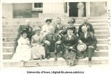 Class of 1876 alumni posed on Old Capitol steps, The University of Iowa, 1910s