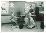 School children making candles and schoolgirl using spinning wheel, The University of Iowa elementary school, 1960