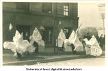 Men dressed in Ku Klux Klan robes in Mecca Day parade, The University of Iowa, 1916