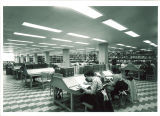 Students studying at tables in Main Library, the University of Iowa, 1970