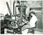 Man operating linograph machine, The University of Iowa, 1950s