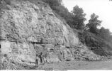 Men in quarry in Devonian limestone, Cedar Valley Stage, Iowa City, Iowa, late 1890s or early 1900s