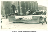 Canoe on Mecca Day parade float, The University of Iowa, 1921