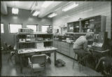 Seated researcher in laboratory, 1973
