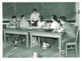 High school students and teacher in classroom, The University of Iowa, 1950s