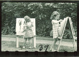 Girls painting pictures outside, The University of Iowa, 1940s