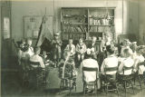 Classroom program with students in Native American costume, The University of Iowa, 1919
