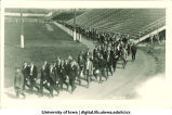 Procession of men on Iowa Field, The University of Iowa, 1920s