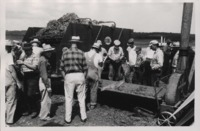 Group of Men Inspect a GEHL Forage Harvester.