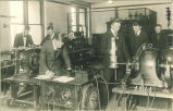 Electrical engineering students with with electrical equipment, The University of Iowa, 1910s