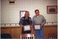 2000 - Robert Brown and J.D. Stucker receive awards at the County Kitchen in Burlington, Iowa