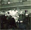 Dentist examining patient, The University of Iowa, 1940s