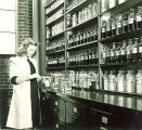Pharmacy student working in a laboratory, The University of Iowa, 1940s