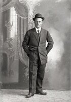 Man standing with hat