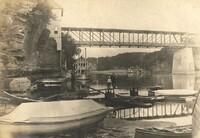 Man and Boy Near River & Bridge<br />