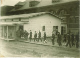 Men going in to the Naval Reserve mess hall, The University of Iowa, 1917