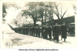 Graduation procession on Washington St. with Engineering Building in background, The University of Iowa, June 1914