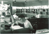 Students in a reading room lounge in Hillcrest, the University of Iowa, 1950