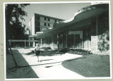 Walking past Burge Residence Hall, the University of Iowa, 1960s?
