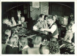 Fourth graders watching glass-blower, The University of Iowa elementary school,  May 11, 1939