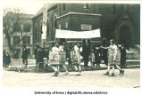Men wearing barrels in Mecca Day parade, The University of Iowa, 1920