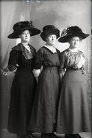 Three women in hats